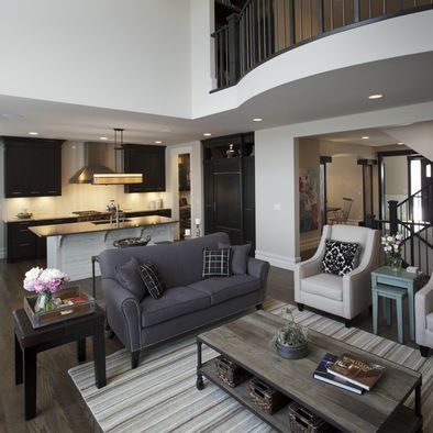 white living room with dark hardwood floors grey couch interior