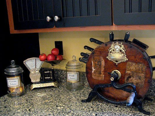 an antique knife sharpener, now functions as a knife rack.