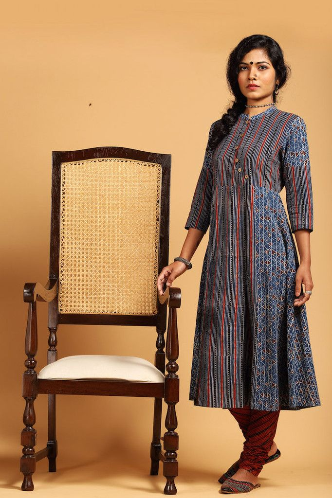 Very elegant vintage chair. Don't care much about the kurta.