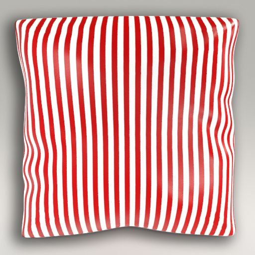 Poducha w biało-czerwone paski idealna do stylizacji w klimacie morskim