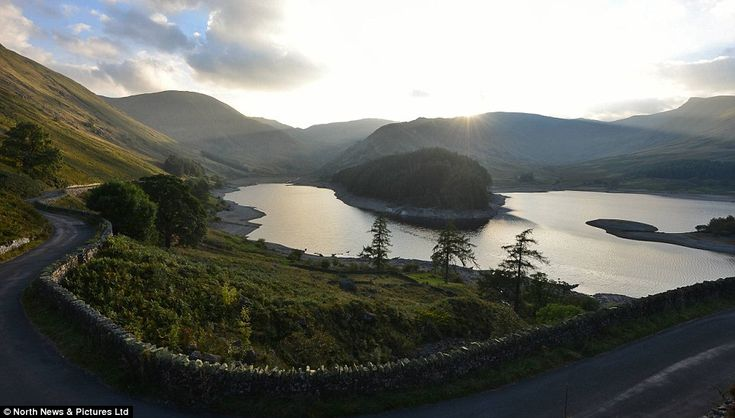 With the warmest September since 1960, the small Cumbrian village of Mardale Green - that has rarely been seen since the 1930s when it was flooded by the Manchester Water Authority to make way for Haweswater Reservoir - is rising from its watery grave