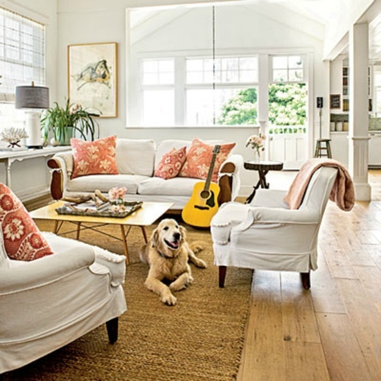 Coastal living room with white slipcover sofa and chairs