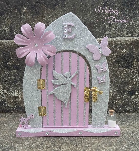 Unique Fairy Door with plenty of sparkles.  Originally designed for the recipient nows your chance to own one too, or why not request your own custom design?  This lovely fairy door comes in its own handmade gift box tied with a coloured ribbon or handmade bow. You can even choose your box colour!  The perfect gift from start to finish. This unique fairy door would make the perfect bedroom accessory for your little one, or even the perfect gift just in time for the tooth fairy or any fairy…