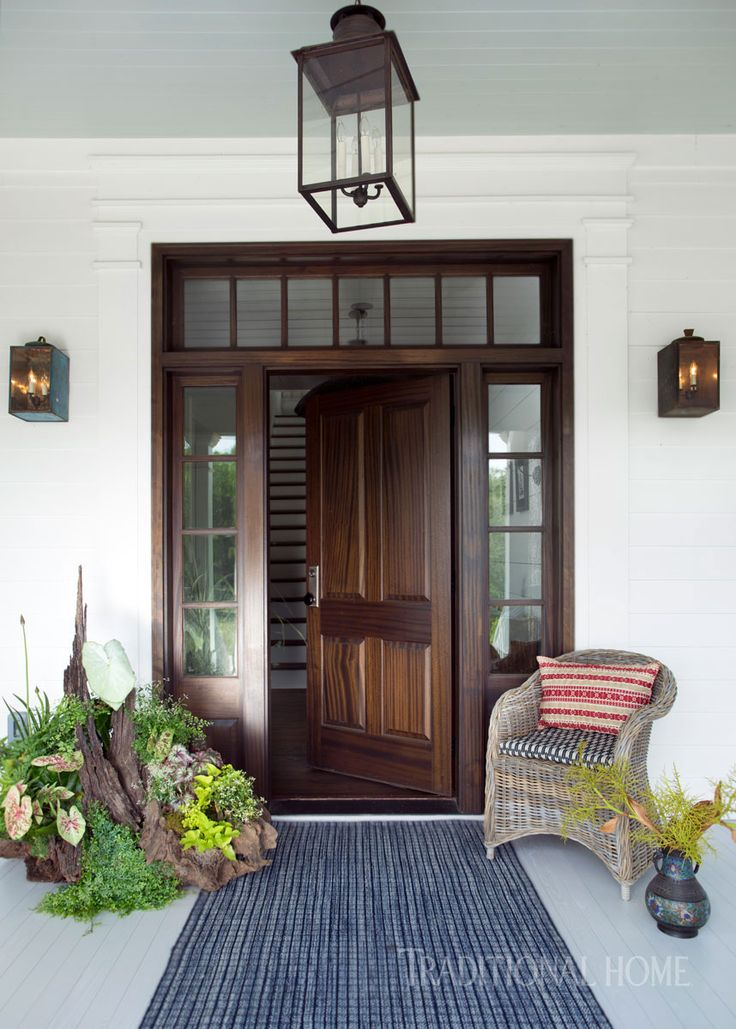 Vintage cracker tins were given new life as lanterns flanking the front door. - Photo: Sarah Dorio / Design: Cloth & Kind