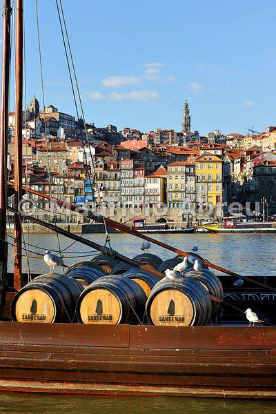 Barrels of wine in a Rabelo boat. Douro river, Oporto, Portugal