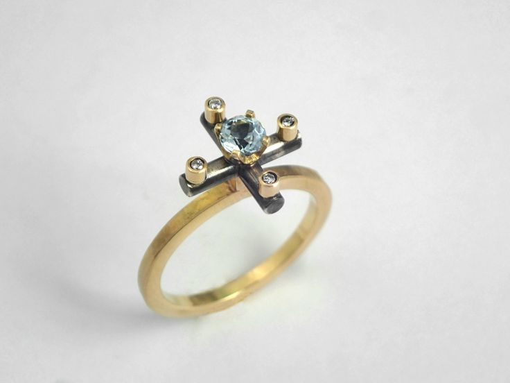 The cross. An alternative 18K solid gold hammered ring decorated with an aquamarine and diamonds. by TomisCraft on Etsy