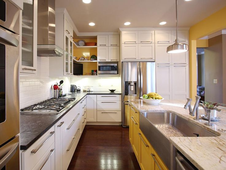 This kitchen was designed to accommodate an enthusiastic cook and entertainer who wanted a contemporary feel that would not be at odds with her colonial townhouse. To create this look, NVS Remodeling & Design used frameless Dura Supreme cabinetry in maple, painting the perimeter units in a creamy white and the island in a surprising splash of yellow (Sherwin Williams Butterfield with Espresso glaze).