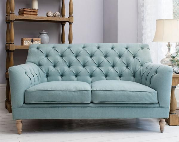 British designed stylish and modern 2 seater sofa with button back in  aquarmarine