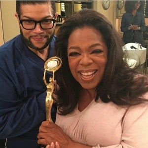 Derrick Rutledge and Oprah celebrating him receiving the 2016 Hollywood Beauty Award.