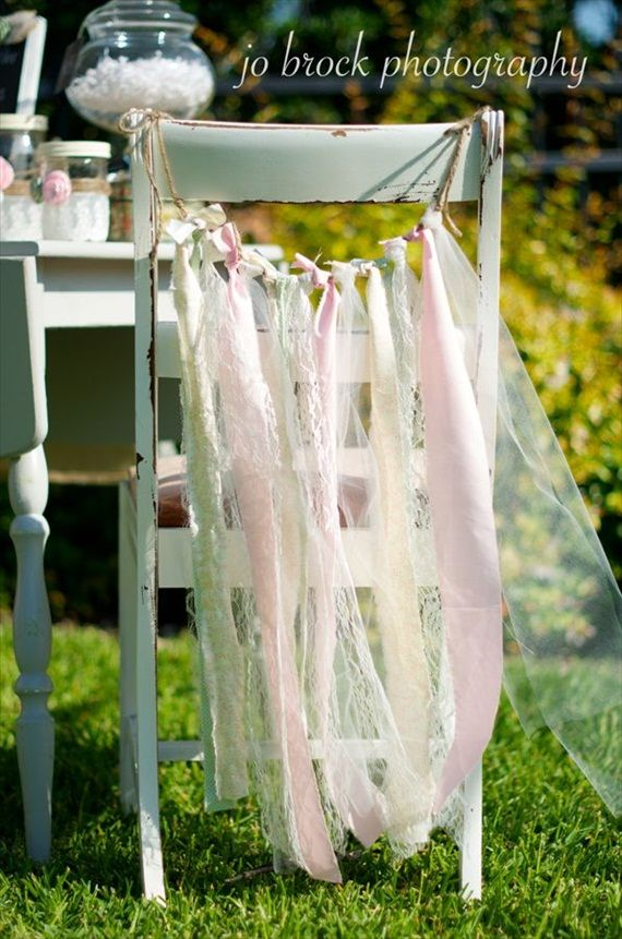 ribbon adorned chair / not only for a wedding, but how about a child's/lady's tea party...birthday...outdoor gathering?