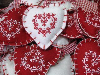 Scandinavian style red and white heart Christmas ornament made out of embroidered felt. #christmas #heart #scandinavian #craft #felt