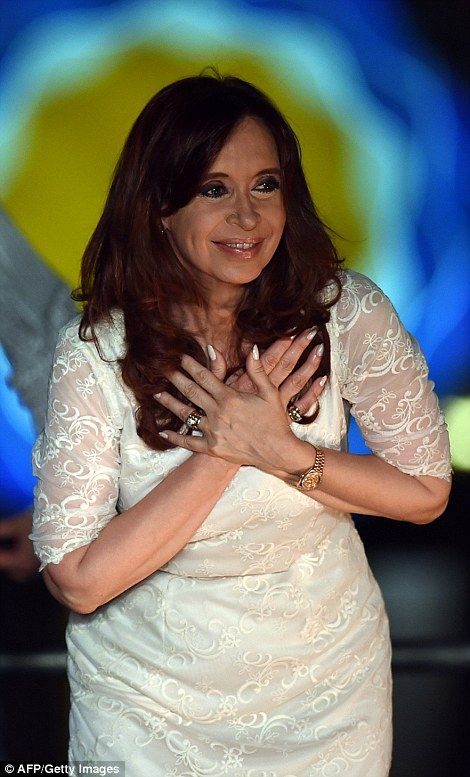 Argentine President Cristina Kirchner gestures during a farewell meeting in Buenos Aires