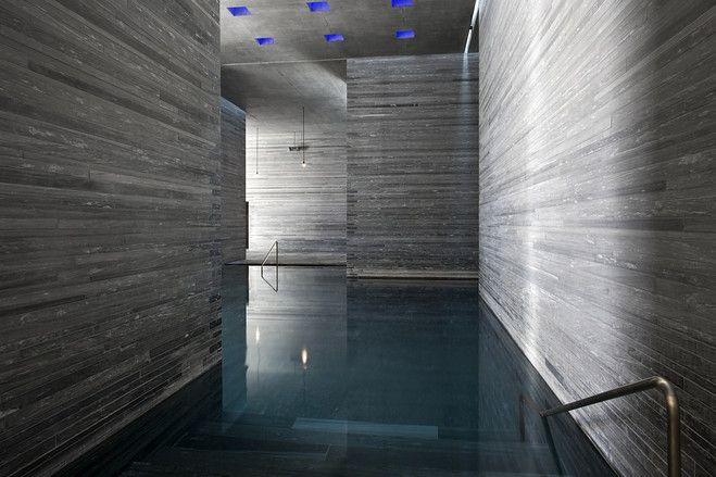 A bath at the Peter Zumthor-designed Therme Vals. The interior is minimalist and angular.
