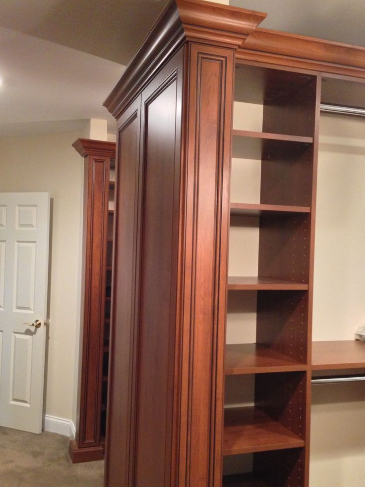 Crown molding and fluted panels give this master walk-in closet the touch of elegance it deserves.