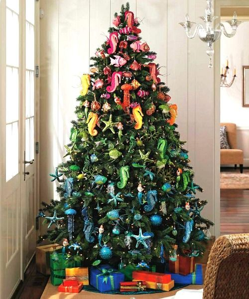 Colorful Beach Christmas Tree. Sea Creature Ornaments are Arranged by Color. Featured on BBL: http://beachblissliving.com/beach-christmas-decorations/