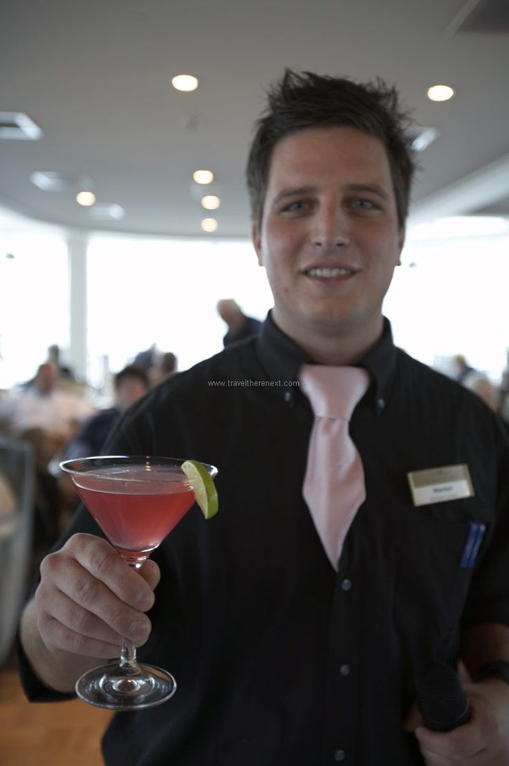 Christmas cruises - Waiter holding a glass of cocktail for the camera  #europe #cruise #christmas #relax #bamberg #shopping #travel #traveltherenext