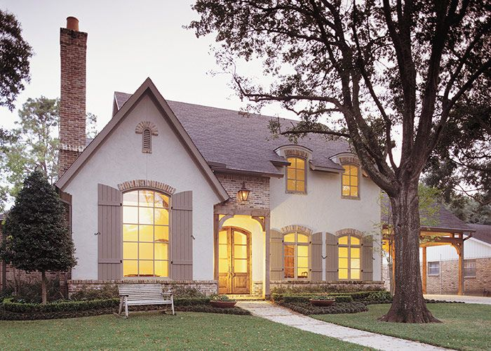 Reclaimed brick chimney with clay chimney pot cypress doors and divided light windows finish this country french home built by röhe wright in briargrove