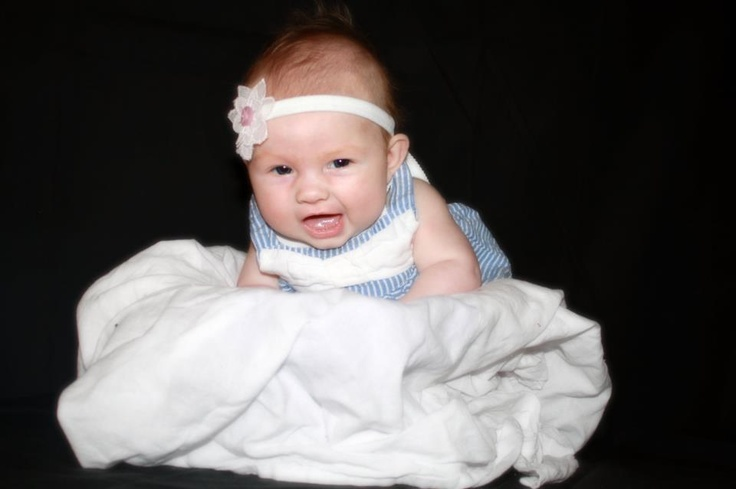 What a cutie wearing a head band by Evee apparel. Find one like this at www.facebook.com/eveeapparel