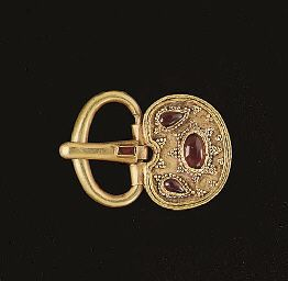 A BYZANTINE GOLD AND GARNET BUCKLE  CIRCA 5TH-6TH CENTURY A.D.