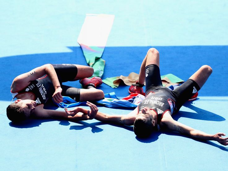 The Brownlee brothers collapse at the finish line after winning gold and silver in the triathlon.