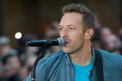 Gwyneth Paltro has admitted her kids are in awe of her husband Chris Martin's career and serve him tea backstage at Coldplay gigs