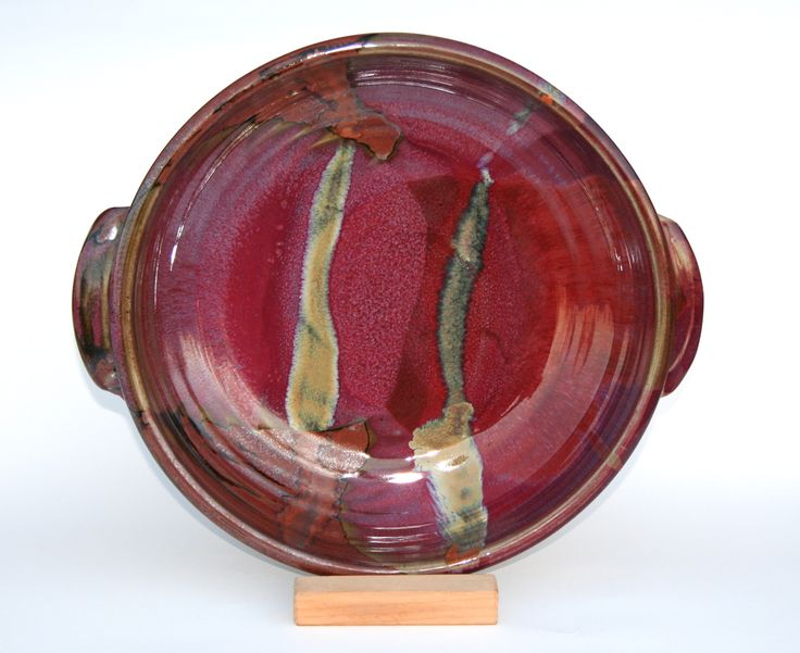 Chez Red / temoky: serving platter / baker - Glossy copper red glaze. Deep tones spanning from copper/rust to venetian reds.  Partnered with a matt brown, with lines of black where the glaze breaks on the edges.