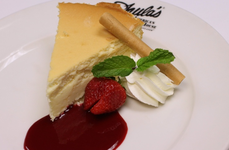 Cheesecake light and creamy with raspberry coulis & an almond tuile at Shula's Steak House at The Saucon Valley Promenade Shops. Located in Center Valley, PA