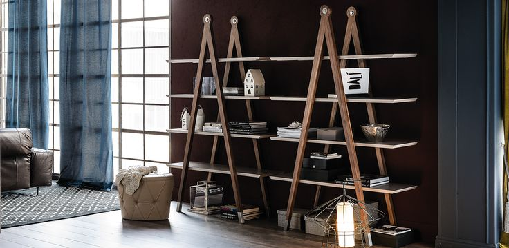 Giotto Bookcase by Cattelan. The simple design is embellished by the structure in Canaletto walnut and by the lacquered shelves available in the colours matt graphite or matt castoro.  Modern but at the same time suitable for classic style spaces, the number of the shelves and the generous dimensions make this bookcase a piece of furniture nice and functional.