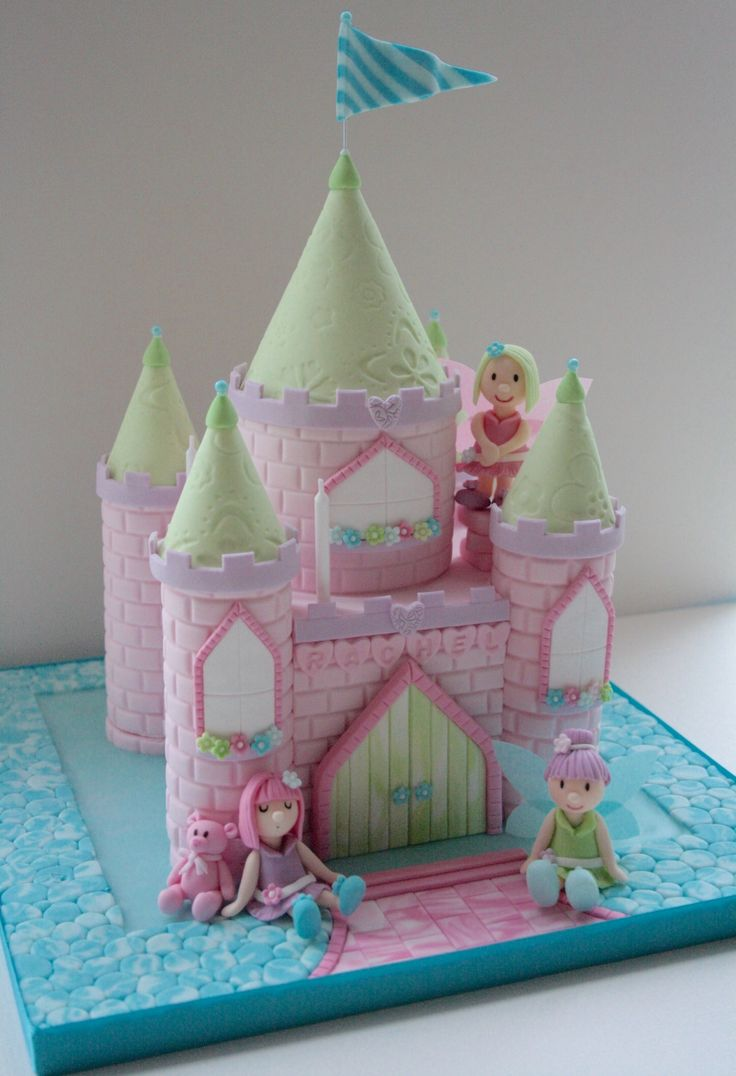 Daughter's pink fairy castle birthday cake round 2. The bottom tier was eaten at the party, so I managed to sit the top tier on the board and make a bit of a 'moat' and we had a cake for her actual birthday too. www.cakehalliday.co.uk