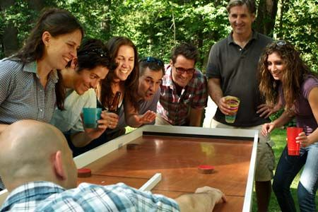 group of happy people standing around a team saturday ricochet game boardBackyards Outdoor, Backyards Games, Games Tables, Ricochet Games, Happy People, Games Boards, Board Games, Old Houses, Ricochet Tables
