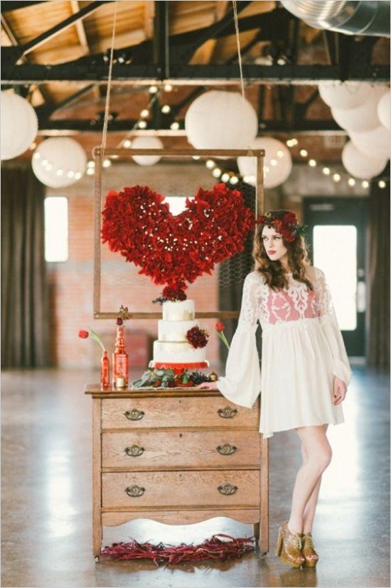red heart diy backdrop behind vintage cake table #caketable #diy #weddingchicks http://www.weddingchicks.com/2014/02/13/spicy-love-wedding-inspiration/