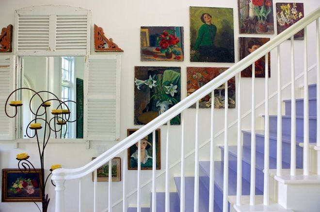 beach style staircase by Alison Kandler Interior Design; love the art going up the stairs