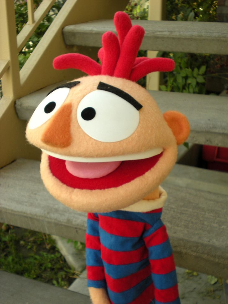 Boy in red and blue stripped pajamas muppet style hand puppet.