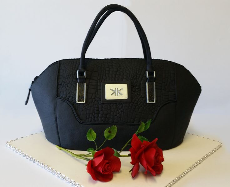 Kim Kardashian bag cake - This was made for a young ladies 18 th birthday 2 ten inch chocolate mud cakes stacked cut and carved, it was life sized Ganached and covered in fondant. Roses were made with Menina flower paste.