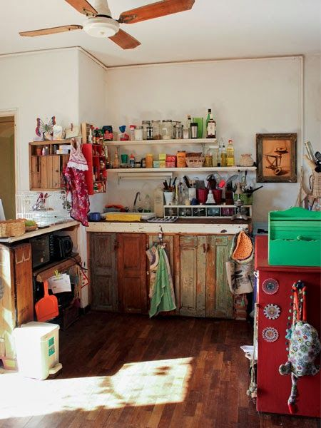 Boho kitchen, wood cabinets and floor. Relaxed and colourful kitchen.A  Beautiful Eclectic Home.