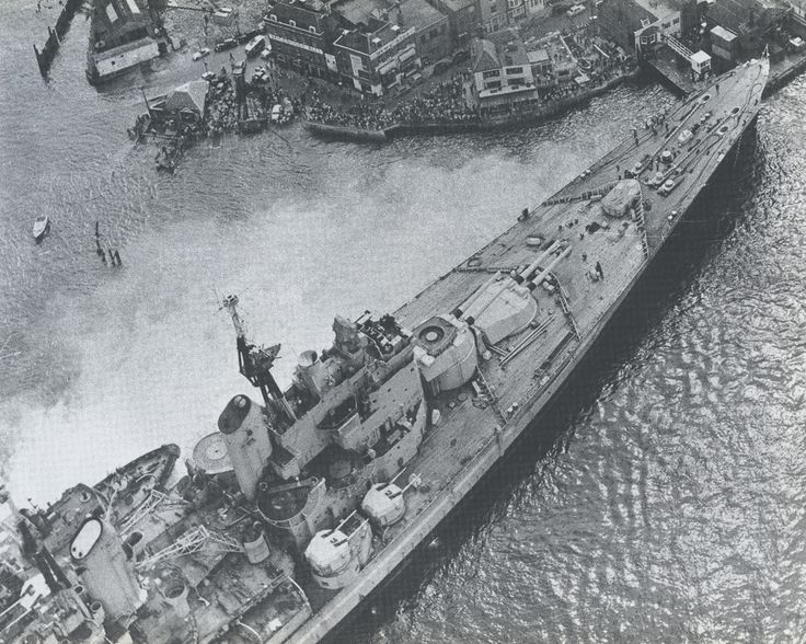 HMS Vanguard pictured in Portsmouth harbour in 1960, the year in which she was de-commissioned.  The last battleship ever to enter service anywhere, she was laid down in 1939 as a 'one off' to make use of stored 15 in guns as war loomed, but competing resource priorities delayed her completion till 1946.