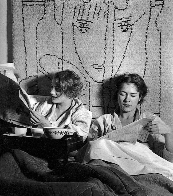 bewarethebibliophilia:Lee Miller and Tanja Ramm having breakfast in bed at Lee's Paris studio, 1931. The wall hanging is from a Jean Cocteau design. Photo by Theodore Miller.