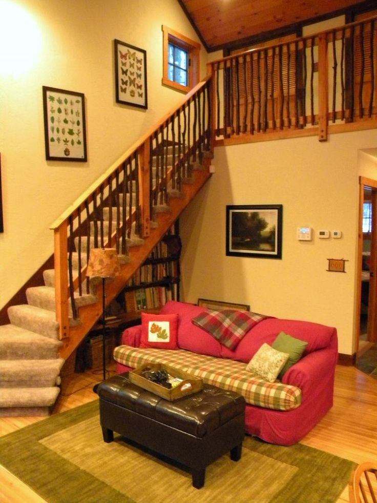 cozy cabin in the woods retreat and fallingwater, home decor, A bookcase was artfully tucked under the staircase