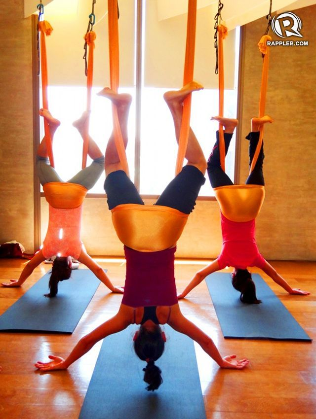 antigravity yoga involves suspensions inversions and more poses with the help of a silk hammock  all photos by rhea claire madara u2026   pinteres u2026 defying gravity  antigravity yoga involves suspensions inversions      rh   pinterest