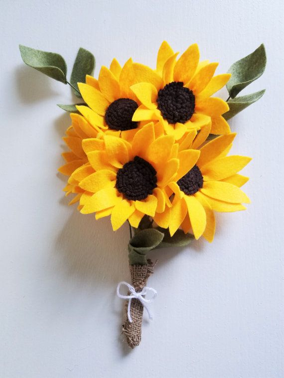 Spread the happiness with this handmade felt sunflower bouquet. Made from premium eco-friendly felt, this beautiful bouquet of sunflowers will last a lifetime! Each sunflower is about 5 inches in diameter and with the wire floral stems measures approximately 12 inches long. Because these are handmade, size may vary. Each bouquet includes 5 sunflowers (gold and cocoa brown), 2 stems of leaves, and is wrapped with burlap and white yarn. If you'd like to expand your bouquet, please message me…