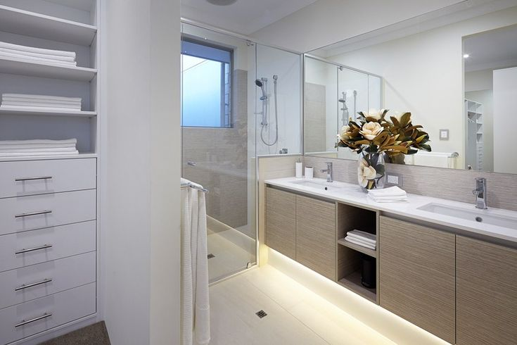 Bathroom features include Hobless showers to ensuite & bathroom + Powder room with vanity & basin. Find out all inclusions here: http://www.redinkhomes.com.au/products/metro/ocean-series/the-milford.aspx