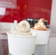 I need to try this:  How to Make Frozen Yogurt Without a Machine