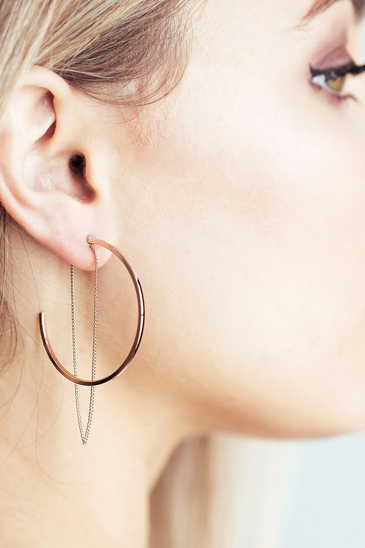 Open hoop earring with a simple chain drop that makes these super unique! The chain on these hoops brings a softer edge to the design. These earrings best complements drape dresses and off shoulder tops.  Hoop size: 38mm Material: High quality gold plating over brass (Nickel & Lead Free) Hypoallergenic Post