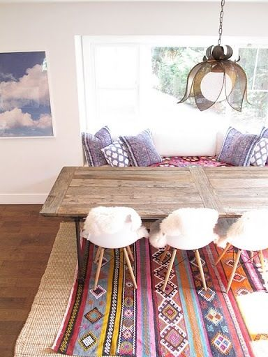 white walls, white chairs, with rustic wood and colorful rug. :)