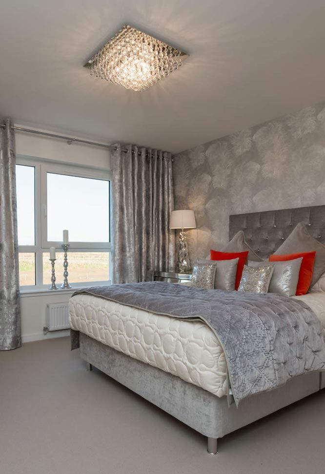 Luxurious master bedroom in grey accents with