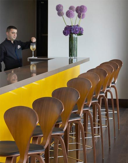 Wembley Hilton, The Manser Practice #hotel #hospitality #interior #design #modern #restaurant #yellow #wood #timber #modernist #natural #relax #minimal #gloss #glazed #color #colour