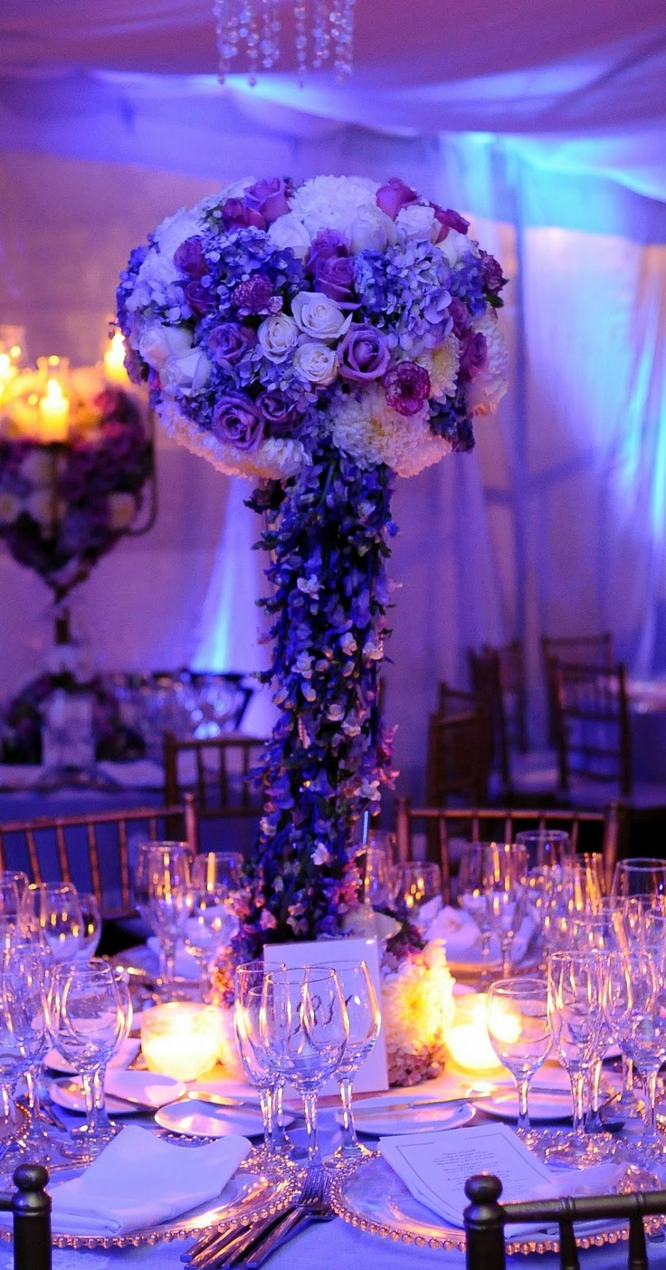 Love the lighting and this setting for the table though I don't know if I would want purple flowers??