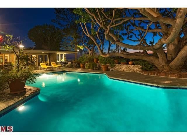 Former home (pool area) of Elvis and Priscilla Presley from 1967 to 1973 in Beverly Hills, CA. Selling for 12.9 million. 1174 North Hillcrest Rd. Beverly Hills, CA.