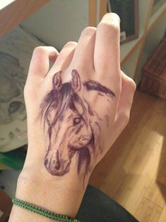 Horse tattoo on hand   #horse #tattoo #horsetattoo #horselover   http://www.islandcowgirl.com/
