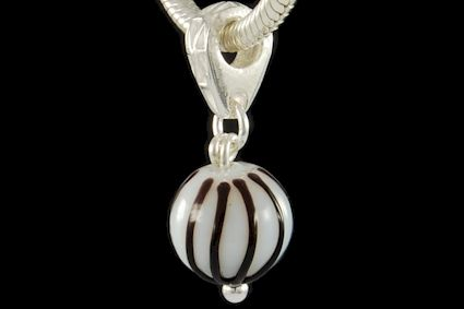 white glass with black high-reliefed stripes, spherical shape. Diameter mm. 12.